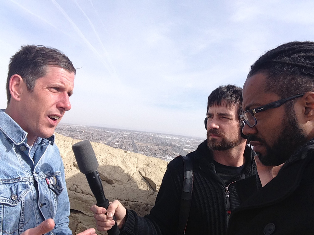 National security reporter GW Schulz (L) talks about the border with Ben Adair (C) and Al Letson